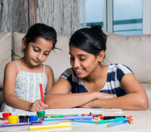 Girl colouring with her mother